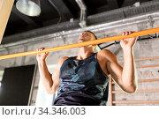 Купить «man exercising on bar and doing pull-ups in gym», фото № 34346003, снято 3 июля 2020 г. (c) Syda Productions / Фотобанк Лори