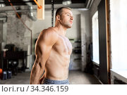 young man with bare torso in gym. Стоковое фото, фотограф Syda Productions / Фотобанк Лори