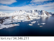 Greenland Sea and coastal mountains. Tasiilaq, East Greenland. April 2018. Стоковое фото, фотограф Franco  Banfi / Nature Picture Library / Фотобанк Лори
