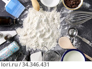flour with baking and cooking ingredients on table. Стоковое фото, фотограф Syda Productions / Фотобанк Лори