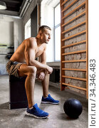 young man with medicine ball in gym. Стоковое фото, фотограф Syda Productions / Фотобанк Лори