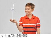 Купить «happy smiling boy holding toy wind turbine», фото № 34346683, снято 2 мая 2020 г. (c) Syda Productions / Фотобанк Лори