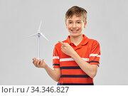 Купить «happy smiling boy holding toy wind turbine», фото № 34346827, снято 2 мая 2020 г. (c) Syda Productions / Фотобанк Лори