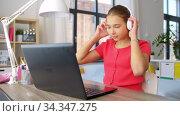 girl in headphones with laptop computer at home. Стоковое видео, видеограф Syda Productions / Фотобанк Лори