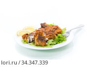 fried hake fish in batter with lettuce and lemon in a plate. Стоковое фото, фотограф Peredniankina / Фотобанк Лори