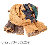 Wrapped stitched scarf from brown silk batik isolated on white background... Стоковое фото, фотограф Zoonar.com/Valery Voennyy / easy Fotostock / Фотобанк Лори