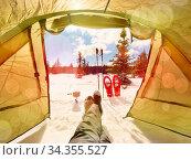 Tent in winter landscape. Trekking tent, poles, red snowshoes on snow... Стоковое фото, фотограф Zoonar.com/rdonar / easy Fotostock / Фотобанк Лори