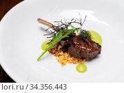 Grilled lamb chop with pesto sauce, international gourmet cuisine... Стоковое фото, фотограф Zoonar.com/Vichie81 / easy Fotostock / Фотобанк Лори