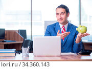 Купить «Young handsome businessman sitting in the office», фото № 34360143, снято 5 августа 2020 г. (c) easy Fotostock / Фотобанк Лори