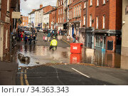 Flooding of St. Martin's Street, after Storm Dennis marking the highest ever recorded level of flooding, Hereford, UK. February 2020. Стоковое фото, фотограф Will Watson / Nature Picture Library / Фотобанк Лори