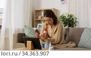 sick woman with medicine has video consultation. Стоковое видео, видеограф Syda Productions / Фотобанк Лори