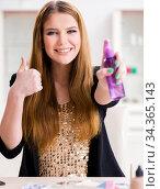 Young woman spraying hair polish to her hair. Стоковое фото, фотограф Elnur / Фотобанк Лори