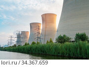 Power plant at dusk, sunset light shines on the cooling towers. Стоковое фото, фотограф Zoonar.com/zhang zhiwei / easy Fotostock / Фотобанк Лори
