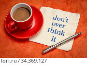 Do not overthink it advice - handwriting on a napkin with a cup of... Стоковое фото, фотограф Zoonar.com/Marek Uliasz / easy Fotostock / Фотобанк Лори