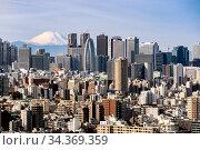 Купить «Mountain Fuji with Tokyo skylines and skyscrapers buildings in Shinjuku...», фото № 34369359, снято 6 августа 2020 г. (c) easy Fotostock / Фотобанк Лори