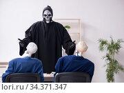Купить «Funny business meeting with devil and skeletons», фото № 34371347, снято 10 декабря 2019 г. (c) Elnur / Фотобанк Лори