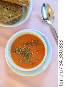 Turkish red lentil cream soup with spices, rye bread on the table in the restaurant. View from above. Стоковая иллюстрация, иллюстратор Tetiana Chugunova / Фотобанк Лори