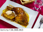 Tasty baked chicken in sauces with potatoes at plate, nobody. Стоковое фото, фотограф Яков Филимонов / Фотобанк Лори