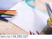 White paper with pencils on wooden table. Стоковое фото, фотограф Яков Филимонов / Фотобанк Лори