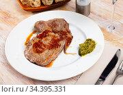 Prepared steak of beef with pesto sauce at plate. Стоковое фото, фотограф Яков Филимонов / Фотобанк Лори