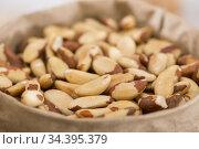 Image of white brasilian nut in container. Стоковое фото, фотограф Яков Филимонов / Фотобанк Лори