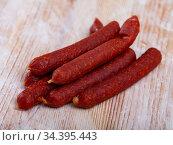 Appetizing tyrolean sausages on wooden table. Стоковое фото, фотограф Яков Филимонов / Фотобанк Лори