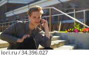 young man calling on smartphone on roof top. Стоковое видео, видеограф Syda Productions / Фотобанк Лори