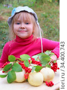 Portrait of little baby with apples and schisandra. Joyful baby smiling... Стоковое фото, фотограф Zoonar.com/Alexmak7 / easy Fotostock / Фотобанк Лори