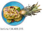 Top view of salad with squid, pineapple on wooden background. Стоковое фото, фотограф Яков Филимонов / Фотобанк Лори