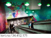 Germany, Frankfurt am Main - escalator of an underground S-Bahn station, as wall decoration a world map. Редакционное фото, агентство Caro Photoagency / Фотобанк Лори