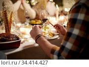 man having christmas dinner at home. Стоковое фото, фотограф Syda Productions / Фотобанк Лори