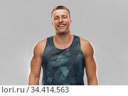 portrait of smiling young man or bodybuilder. Стоковое фото, фотограф Syda Productions / Фотобанк Лори