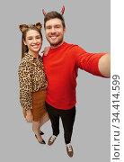 happy couple in halloween costumes taking selfie. Стоковое фото, фотограф Syda Productions / Фотобанк Лори