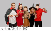 friends in halloween costumes scaring. Стоковое фото, фотограф Syda Productions / Фотобанк Лори