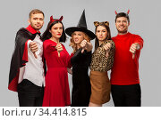 friends in halloween costumes snow thumbs down. Стоковое фото, фотограф Syda Productions / Фотобанк Лори