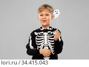 boy in halloween costume with ghost decoration. Стоковое фото, фотограф Syda Productions / Фотобанк Лори
