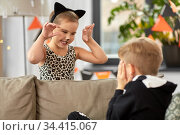 kids in halloween costumes playing at home. Стоковое фото, фотограф Syda Productions / Фотобанк Лори