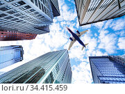 View from below on airplane between skyscrapers. Стоковое фото, фотограф Сергей Новиков / Фотобанк Лори