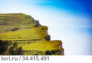 Etretat famous green grass cliffs over blue sky (2017 год). Стоковое фото, фотограф Сергей Новиков / Фотобанк Лори