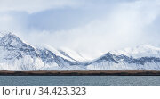Icelandic landscape with coastal snowy mountains (2017 год). Стоковое фото, фотограф EugeneSergeev / Фотобанк Лори