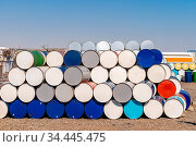 Industry oil chemical metal barrels stacked up in waste yard of tank... Стоковое фото, фотограф Zoonar.com/Vichie81 / easy Fotostock / Фотобанк Лори