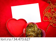 Heart with a blank card on red background. Стоковое фото, фотограф Zoonar.com/Ruslan Gilmanshin / age Fotostock / Фотобанк Лори
