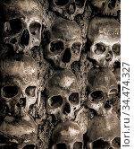 Wall full of skulls and bones in the bone chapel in Evora, Portugalhe... Стоковое фото, фотограф Zoonar.com/Ruslan Gilmanshin / age Fotostock / Фотобанк Лори