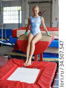 Woman trampolining in acrobatic hall. Стоковое фото, фотограф Яков Филимонов / Фотобанк Лори