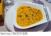 Delicious chickpea soup - traditional dish of Catalan cuisine. Стоковое фото, фотограф Яков Филимонов / Фотобанк Лори