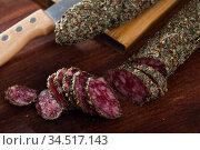 Sliced spanish sausage fuet with herbs. Стоковое фото, фотограф Яков Филимонов / Фотобанк Лори