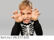 boy in halloween costume of skeleton making faces. Стоковое фото, фотограф Syda Productions / Фотобанк Лори