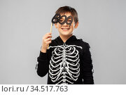 boy in halloween costume of skeleton with props. Стоковое фото, фотограф Syda Productions / Фотобанк Лори