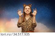 happy woman in halloween costume of leopard. Стоковое фото, фотограф Syda Productions / Фотобанк Лори