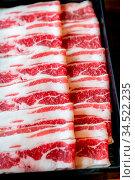 Raw Beef meat set ready to cook Shabu shabu and sukiyaki. Стоковое фото, фотограф Zoonar.com/Vichie81 / easy Fotostock / Фотобанк Лори
